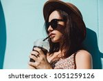 woman drinking vegetable... | Shutterstock . vector #1051259126