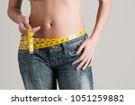 woman with ruler  diet concept   Shutterstock . vector #1051259882