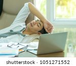 young asian businessman tired...   Shutterstock . vector #1051271552