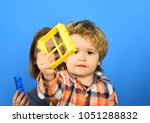 parent watches kid playing with ...   Shutterstock . vector #1051288832