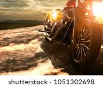 old retro motorcycle traveling... | Shutterstock . vector #1051302698
