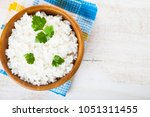 boiled rice in a wooden bowl on ... | Shutterstock . vector #1051311455