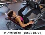 woman in gym doing strength... | Shutterstock . vector #1051318796