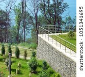 protective gabion wall and... | Shutterstock . vector #1051341695