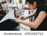 female artisan threading black... | Shutterstock . vector #1051342712