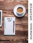2018 goals on his notebook. new ... | Shutterstock . vector #1051359128