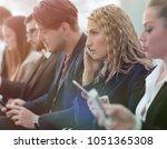 closeup of colleagues sitting... | Shutterstock . vector #1051365308