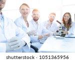 head of the scientific project... | Shutterstock . vector #1051365956