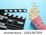 clapperboard and popcorn on... | Shutterstock . vector #1051387505