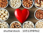 different types of nuts in... | Shutterstock . vector #1051398962