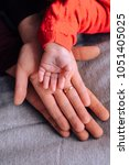 hand mom  dad and baby | Shutterstock . vector #1051405025
