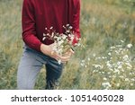 guy gathers a bunch of... | Shutterstock . vector #1051405028