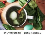 homemade painting easter eggs... | Shutterstock . vector #1051430882