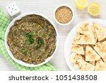 homemade roasted eggplant dip... | Shutterstock . vector #1051438508