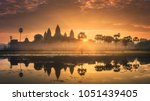 Small photo of Sunrise view of popular tourist attraction ancient temple complex Angkor Wat with reflected in lake Siem Reap, Cambodia