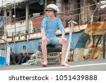 portrait of a boy in a vest ... | Shutterstock . vector #1051439888