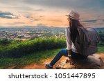 traveler asian woman with... | Shutterstock . vector #1051447895