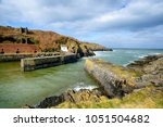the pretty harbour at porthgain ... | Shutterstock . vector #1051504682