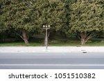 street road side view. sidewalk ... | Shutterstock . vector #1051510382