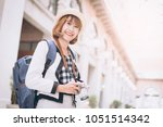 travel guide. young female... | Shutterstock . vector #1051514342