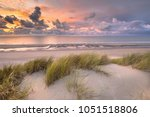 Small photo of Sunset View from dune top over North Sea and Canal in Zeeland, Netherlands