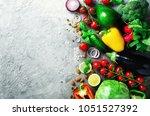set of fresh vegetables on grey ... | Shutterstock . vector #1051527392