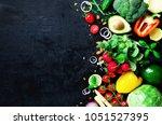 set of fresh vegetables on a... | Shutterstock . vector #1051527395