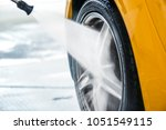car washing with soap and high... | Shutterstock . vector #1051549115