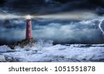 Lighthouse in stormy landscape  ...