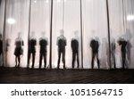 the silhouette of the men... | Shutterstock . vector #1051564715
