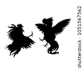 silhouettes of fighting cocks....   Shutterstock .eps vector #1051567562