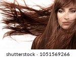 beautiful woman wearing subtle... | Shutterstock . vector #1051569266