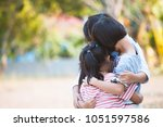 group of asian children hugging ... | Shutterstock . vector #1051597586