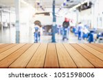 empty wooden board or table and ... | Shutterstock . vector #1051598006