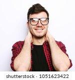 beautiful young man wearing... | Shutterstock . vector #1051623422
