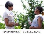 two young sportswomen standing... | Shutterstock . vector #1051625648