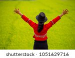 woman in red dress action feel... | Shutterstock . vector #1051629716