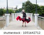 young beautiful flamenco... | Shutterstock . vector #1051642712