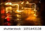 cars in zigzag on rua do brasil.... | Shutterstock . vector #1051643138