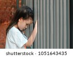 lonely 5 years old asian girl... | Shutterstock . vector #1051643435