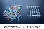Small photo of The idea of diversity versus order shown with colorful chemical vials