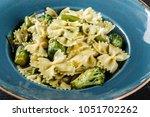vegan farfalle pasta in a... | Shutterstock . vector #1051702262