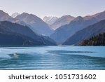 scenery of heaven lake ... | Shutterstock . vector #1051731602