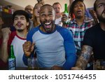 frieds cheering sport at bar... | Shutterstock . vector #1051746455