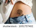 closeup of lower hip tattoo of... | Shutterstock . vector #1051757402