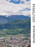 Small photo of Aeria Scenery of Old Town Cityscape from Thun Castle and Alpine Mountain Range in Switzerland with Cloudy. Swiss Village among Swiss Alps. Scenic Landscape of Switzerland Country with Snowy Mountain.