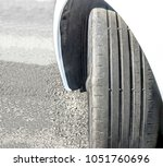 badly worn out car tire tread...   Shutterstock . vector #1051760696