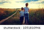 little boy and girl in the... | Shutterstock . vector #1051810946