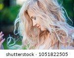 beautiful  slender bride in a... | Shutterstock . vector #1051822505
