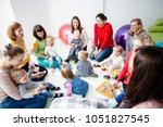 young moms with their kids | Shutterstock . vector #1051827545